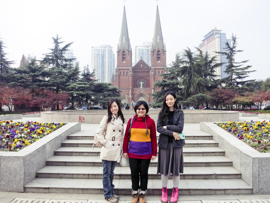 Ade, Puey, and Ren standing in front of St. Ignatius Cathedral, Shanghai. Photo from Ade.