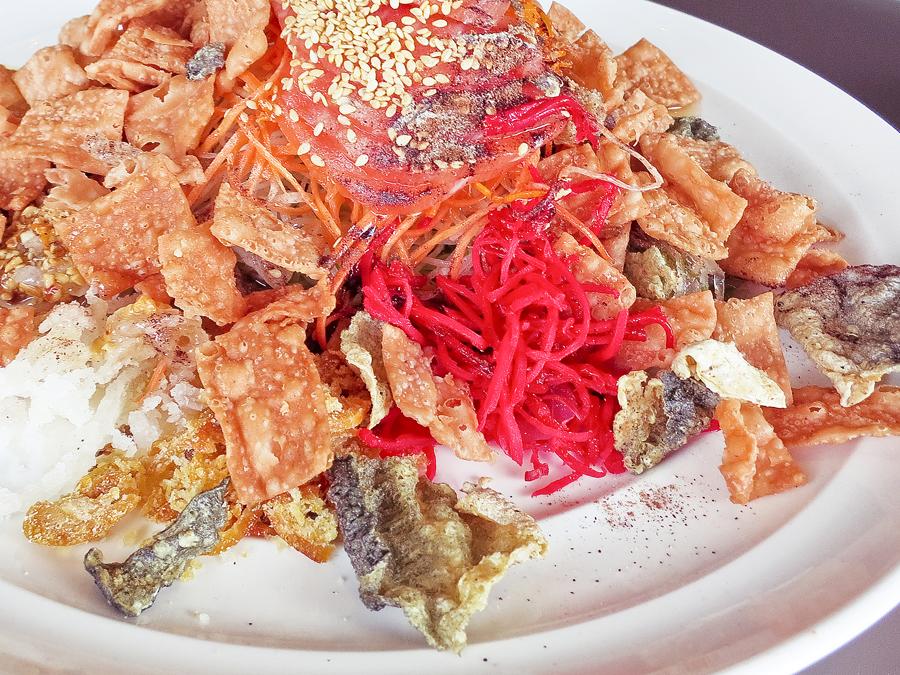 Prosperity Salmon Yusheng with Crispy Fish Skin at Tian Fu Tea Room by Si Chuan Dou Hua in Singapore.