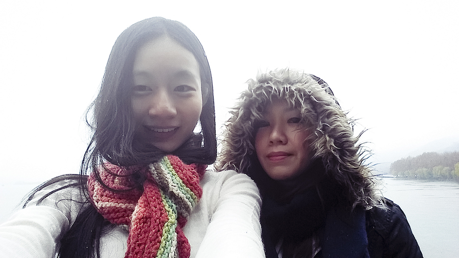 Ren and Ade amidst snow in West Lake, Hangzhou.