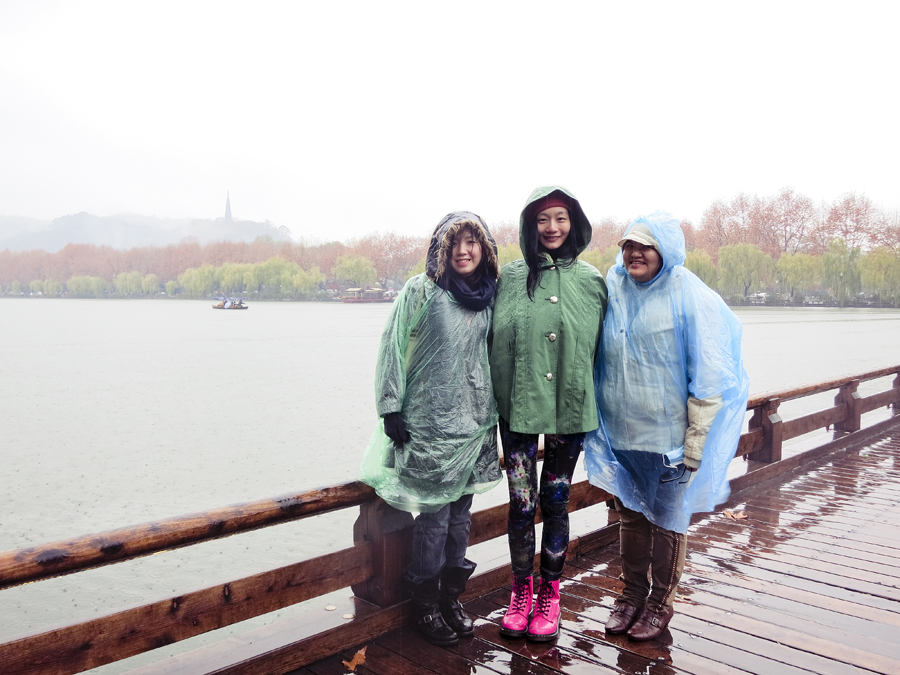 Ade, Ren, and Puey in the rain at West Lake, Hangzhou. Photo from Ade.
