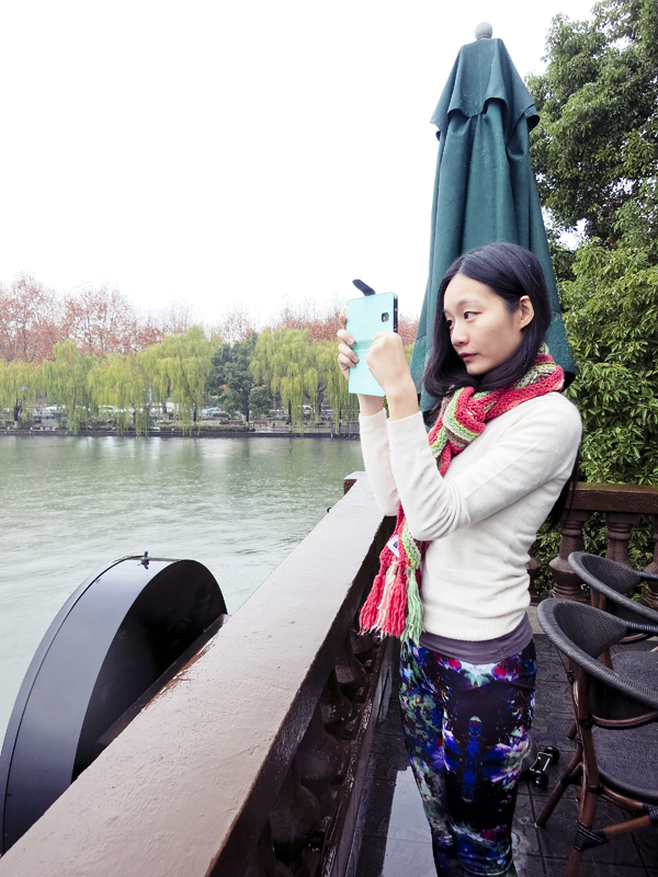 Ren taking photos of the first snow in West Lake, Hangzhou. Photo by Ade.