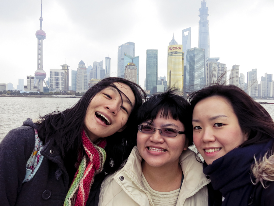 Ren, Puey, and Ade at the Bund, Shanghai. Photo by Ade.