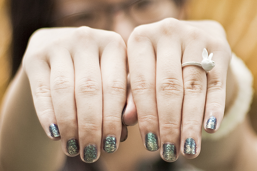 Mermaid nails and white rabbit ring.