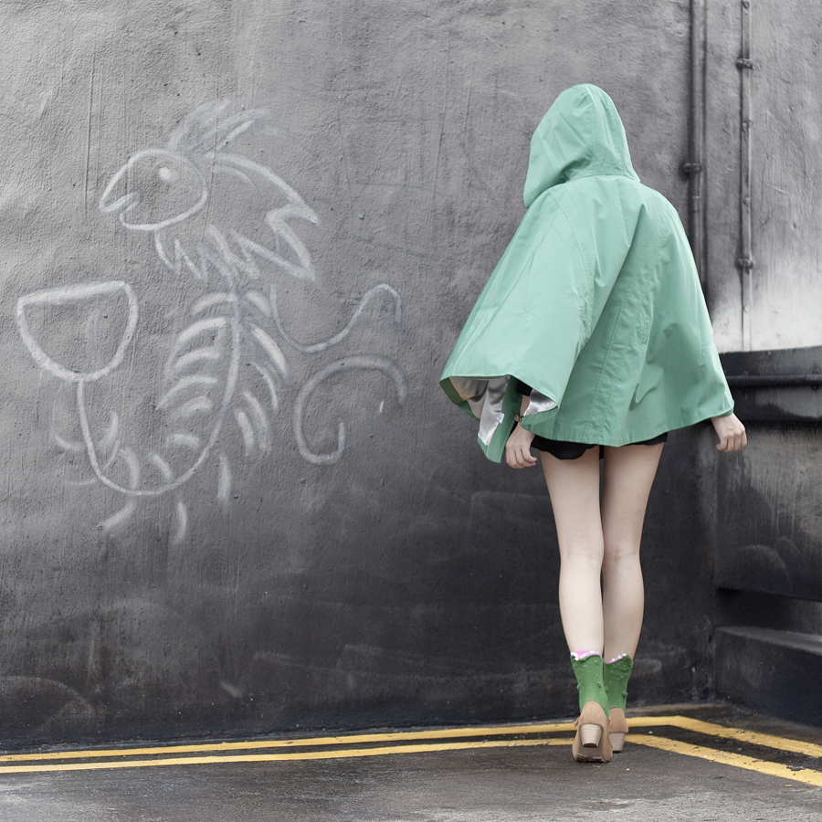 Green raincoat cape from Calvin Klein.