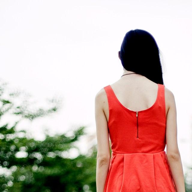 Back detail of orange-red sleeveless dress from Forever 21.