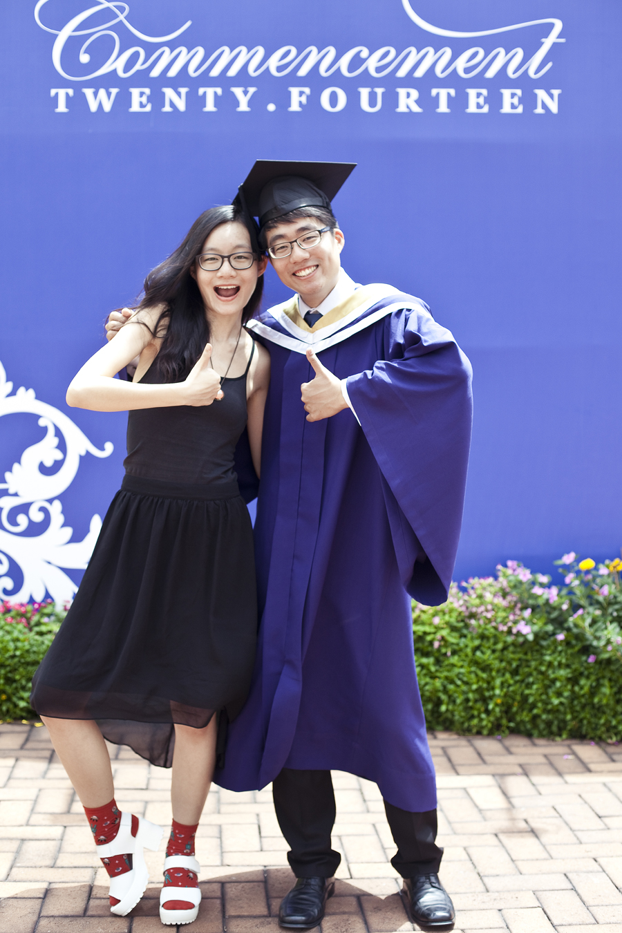 Ren and brother at the NUS Commencement 2014.