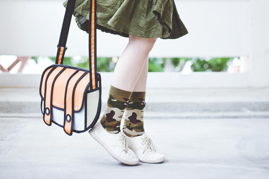 Stance camo socks, Cotton On lace-ups, green flare skirt, orange 2D sling bag.