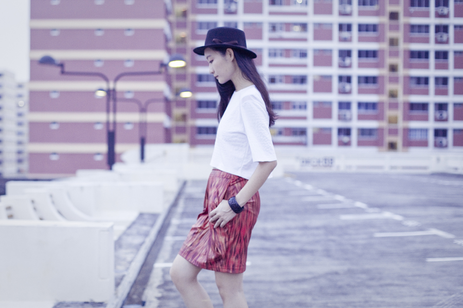 Outfit wearing white textured crop top from Bec & Bridge via Shopbop, Club Marc snakeskin print skirt, black felt hat from Taobao.