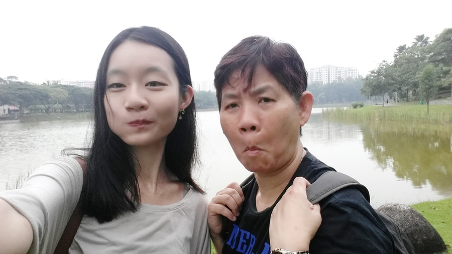 Making funny faces with Mum Wefie selfie at a park in Singapore.