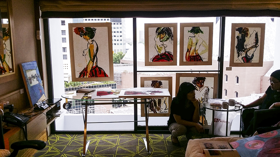 Drawings and paintings on display at the Pan Pacific Hotel room for the Bank Art Fair 2014 in Singapore.