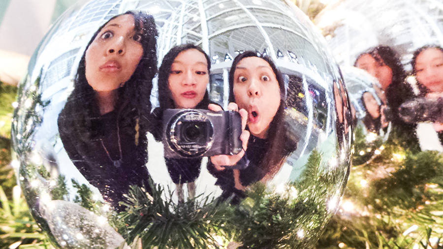 Mirror selfie at a christmas bauble reflection at Marina Bay Sands.