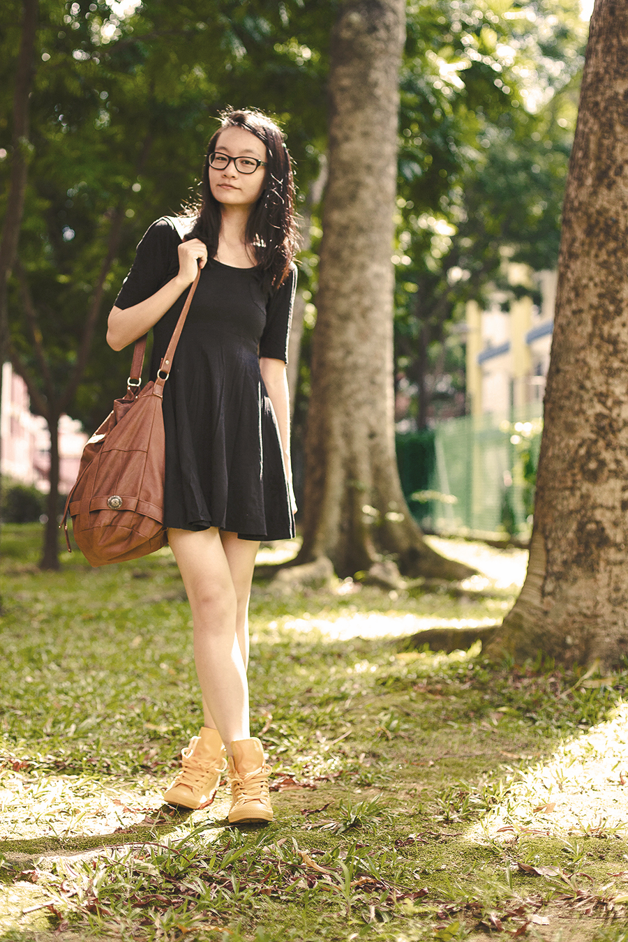 Summer outfit details: Forever 21 little black scoop back dress, Gentle Fawn brown leather sling bag, Converse All star Chuck Taylor yellow Rubber Coated Sneakers, Gap black frame glasses.