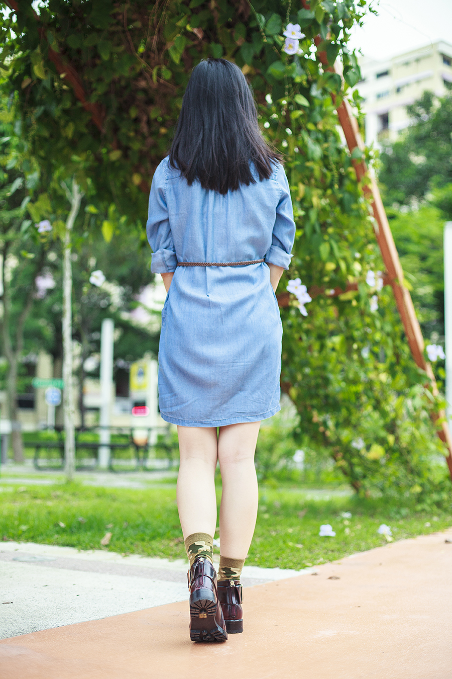 Back view: Uniqlo denim long-sleeved dress, brown braid thin belt, Gap black frame glasses, Stance green camouflage socks, Jeffrey Campbell Flamel cutout booties in wine.