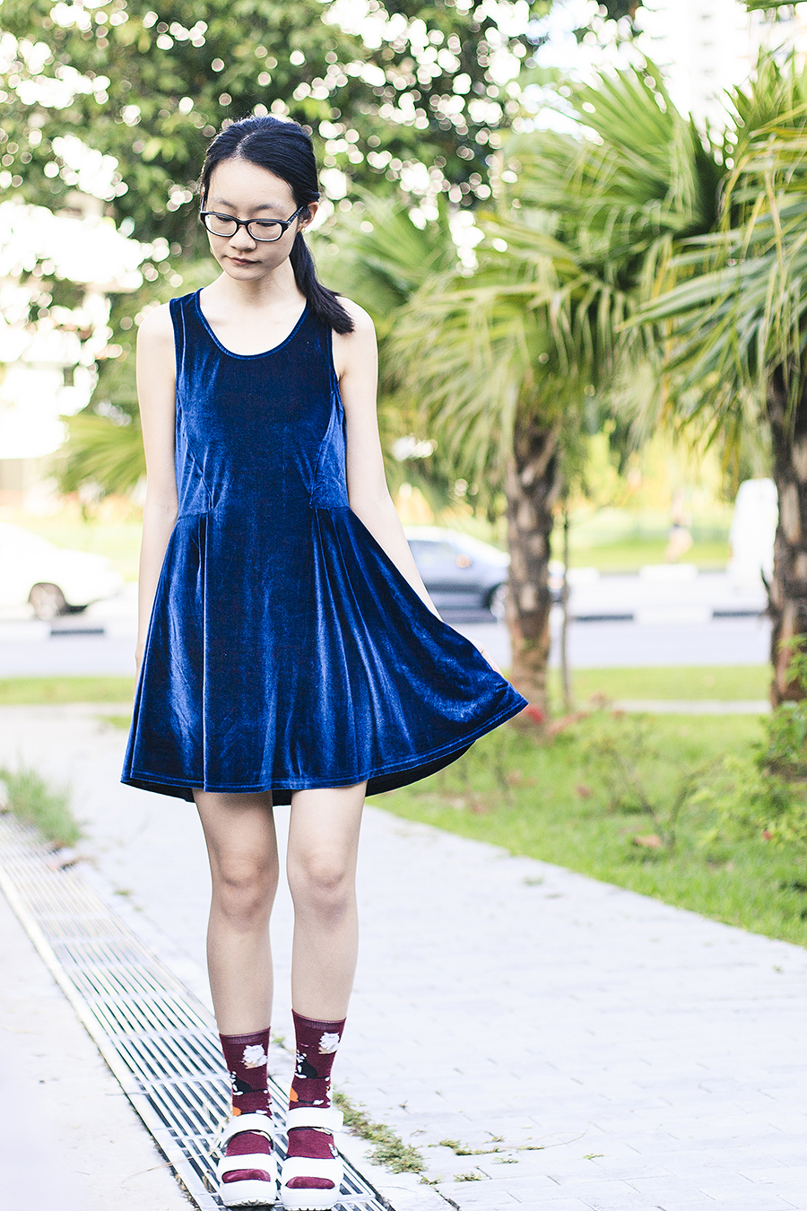Blue velvet dress from Cotton On, black frame prescription glasses from Gap, cat socks from Taobao, white platform sandals from Taobao.
