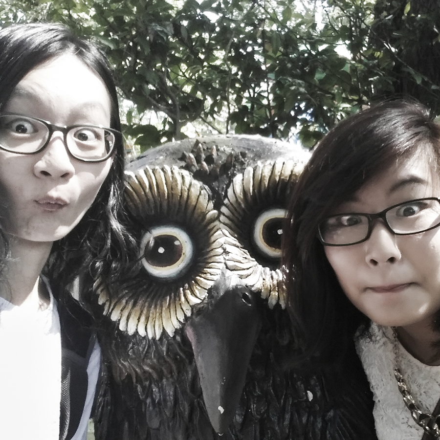 Jesca and I making owl faces in front of an owl statue at Haw Par Villa, Singapore.