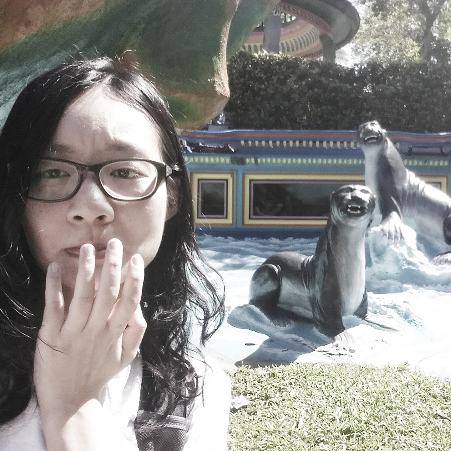 Selfie with scary statues of seals at Haw Par Villa, Singapore.