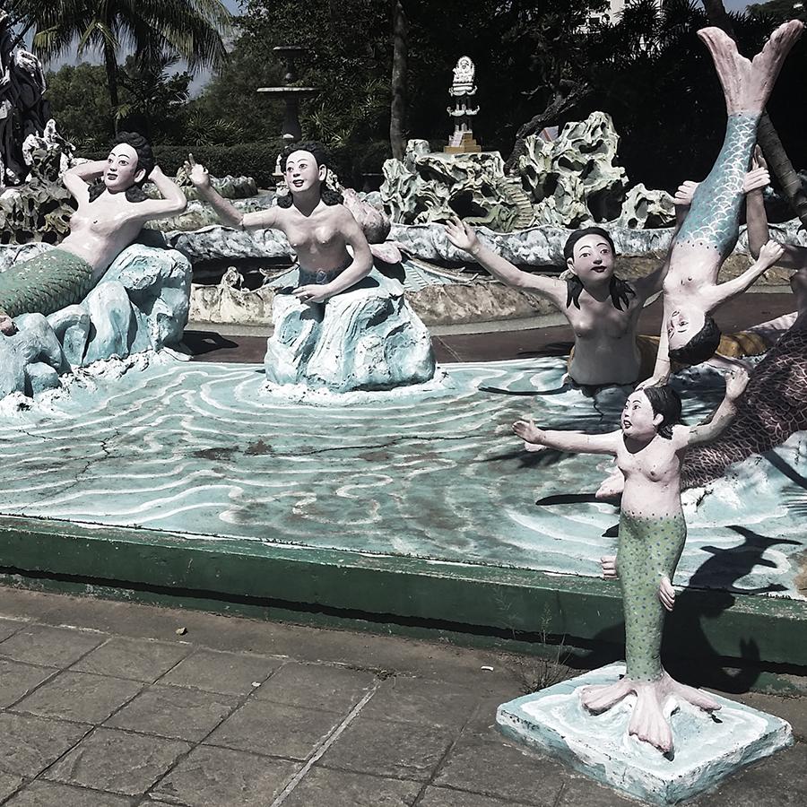 Weird mermaid statues at Haw Par Villa, Singapore.