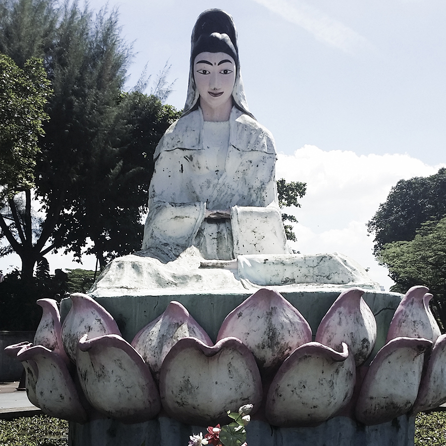 Statue of the buddhist goddess of mercy at Haw Par Villa, Singapore.