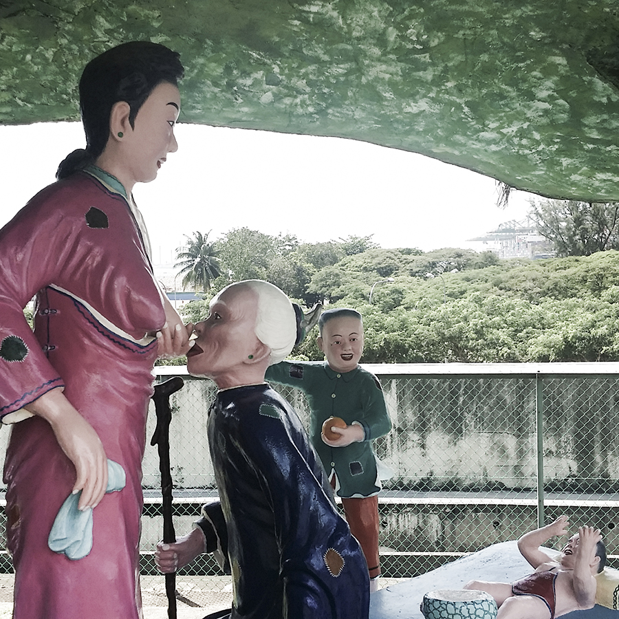 Scene of filial piety in which a woman breastfeeds her elderly mother outside the Ten Courts of Hell (十八晨地狱) at Haw Par Villa, Singapore.