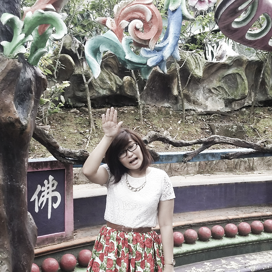 Jesca and her outfit at Haw Par Villa, Singapore