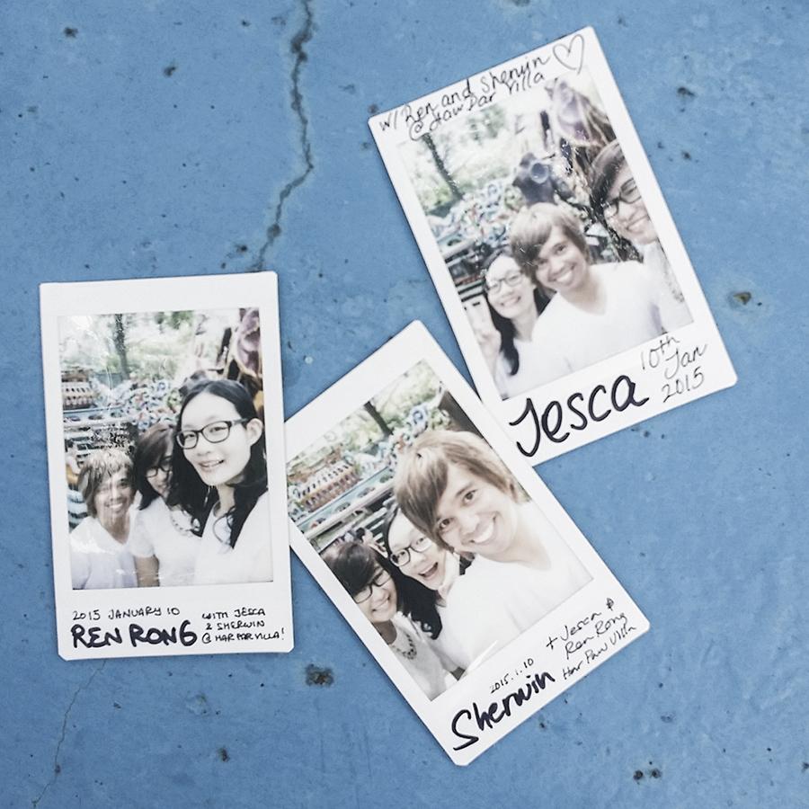 Instax polaroid photos of Shamis, Jesca, and Ren at Haw Par Villa, Singapore.