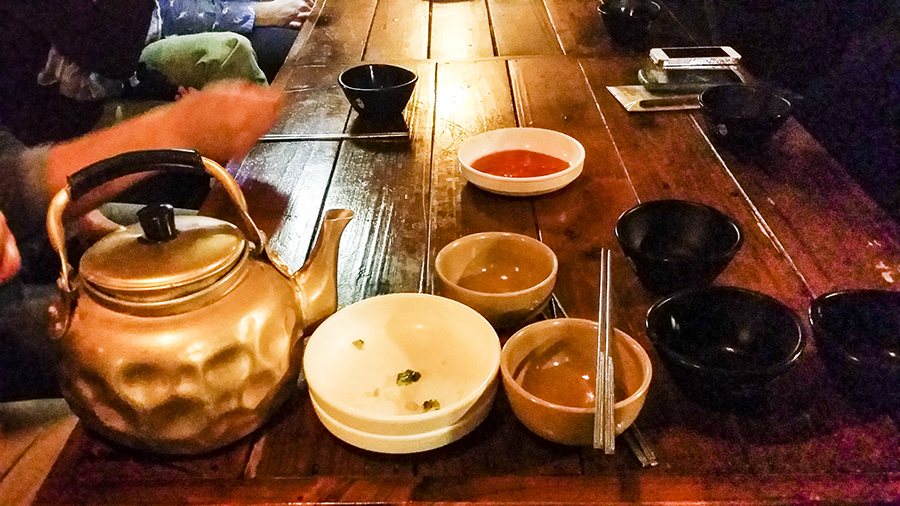 Golden kettle of Makgeolli and side dishes at the Makgeolli Place, Sangju.