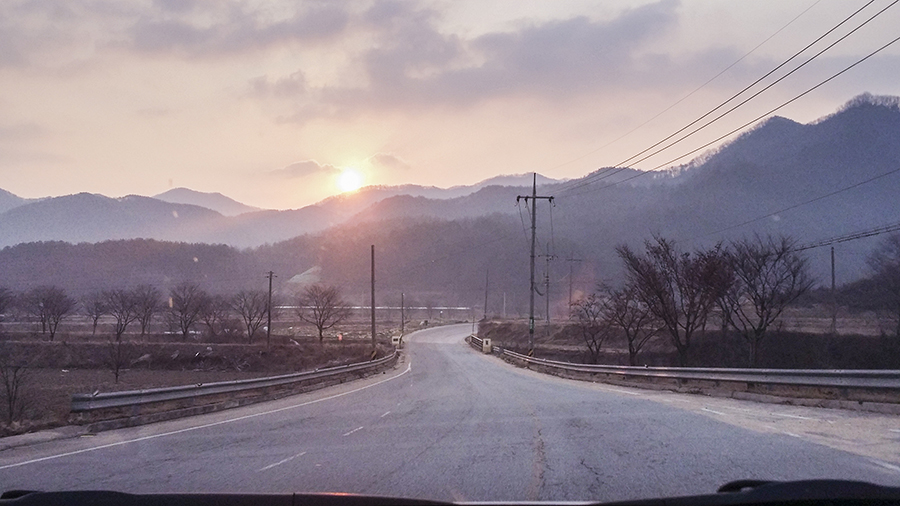 Scenic view of the sunrise driving up a mountain in Sangju, South Korea.