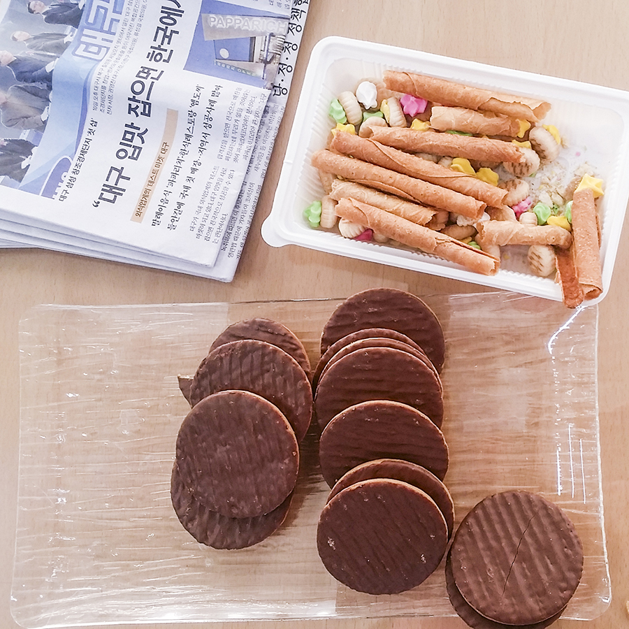 Morning snacks of cookies and biscuits from Singapore and chocolate-coated tea biscuits in Sangju, South Korea.