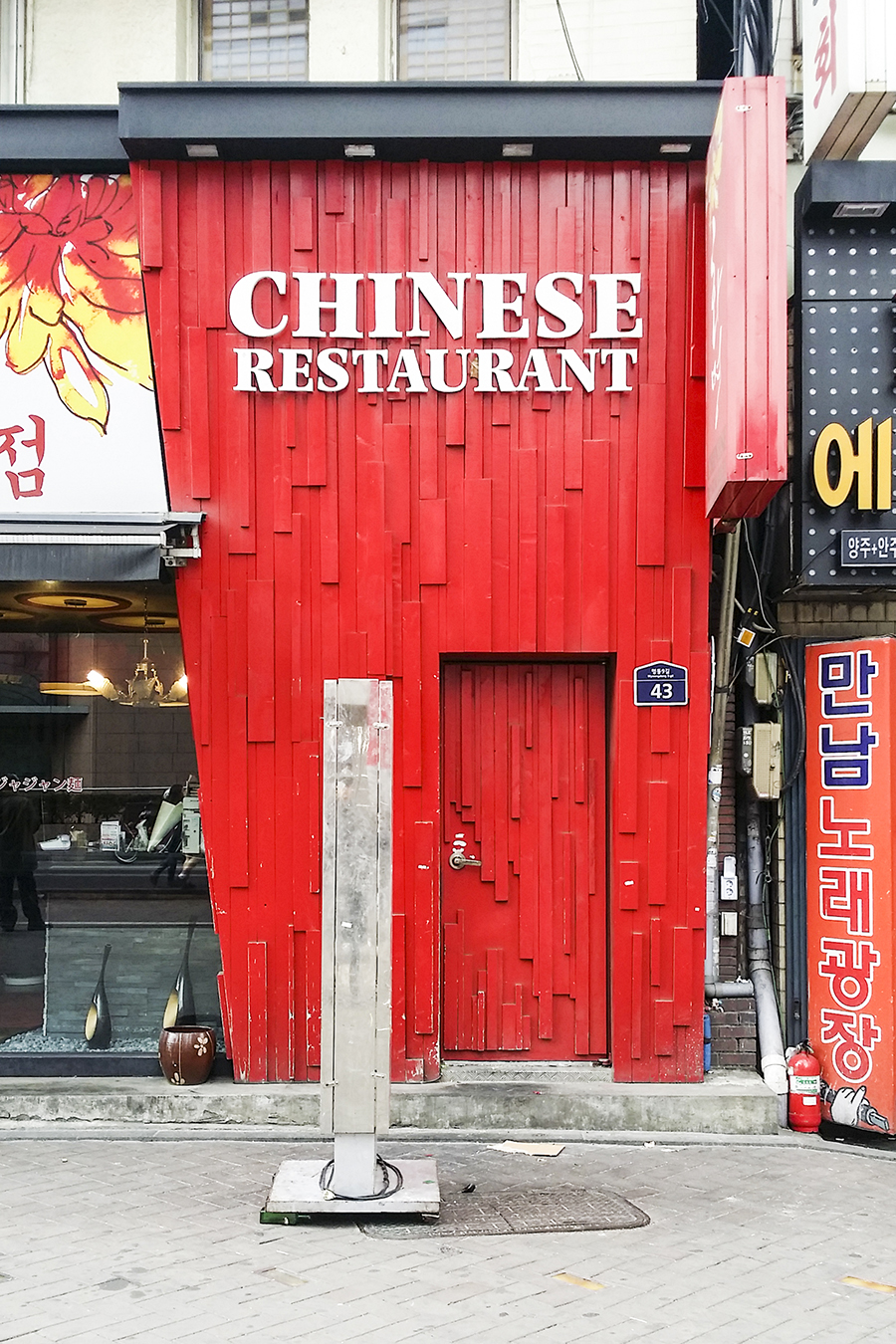 Chinese Restaurant in the shape of a chinese takeaway box in Myeongdong, Seoul, South Korea.
