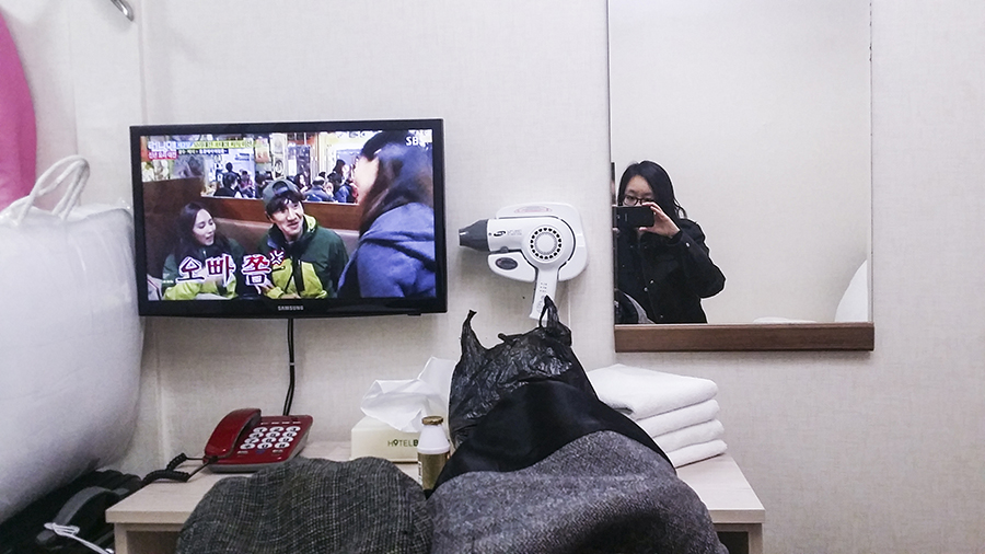 Watching Korean variety show Running Man in Hotel Bonbon, Seoul, South Korea.