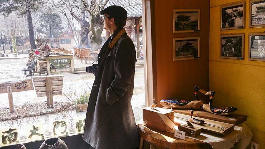Ottie peering out a window of a gallery at Nami Island, Gapyeong, South Korea.