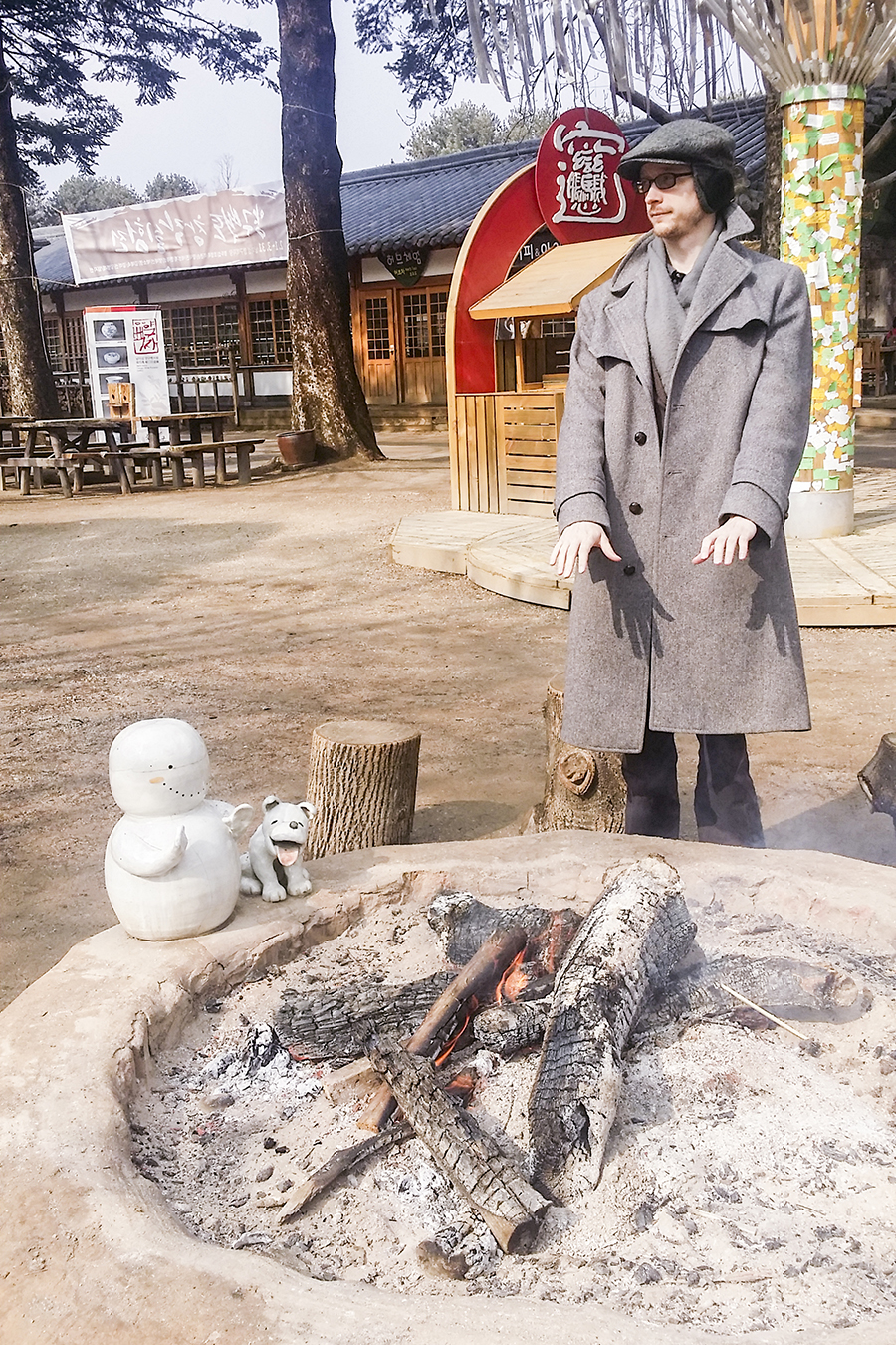 Ottie warming his hands over one of the many open fireplaces at Nami Island, Gapyeong, South Korea.