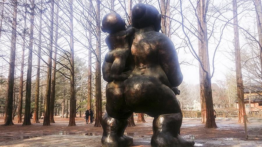 Huge mother feeding child sculpture at Nami Island, Gapyeong, South Korea.