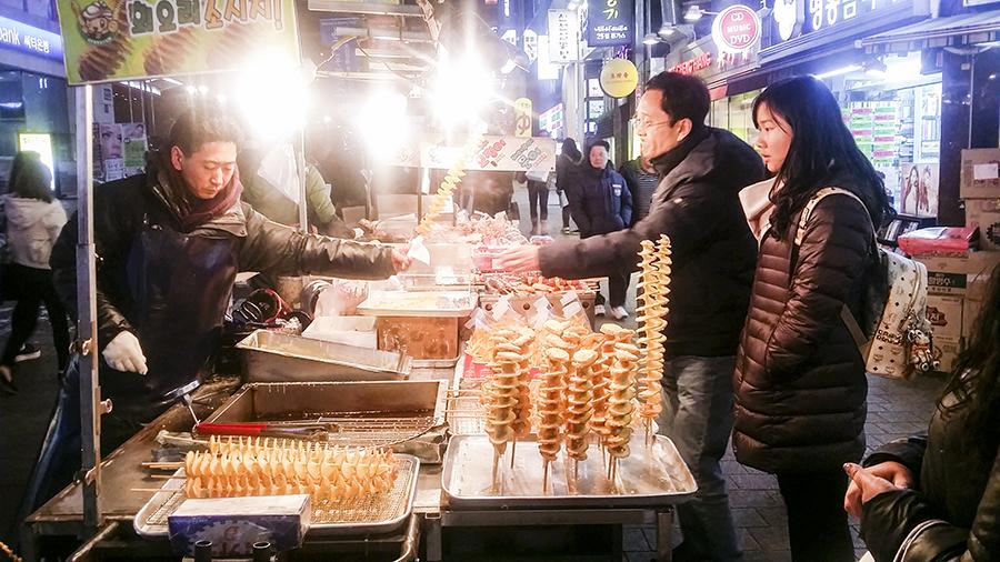 Roadside stall selling twistie potato sticks in Myeongdong, Seoul, South Korea.