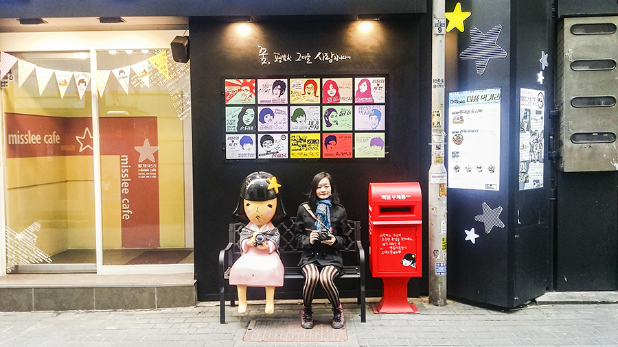 Picture with cute statue outside Miss Lee Cafe in Myeongdong, Seoul, South Korea.