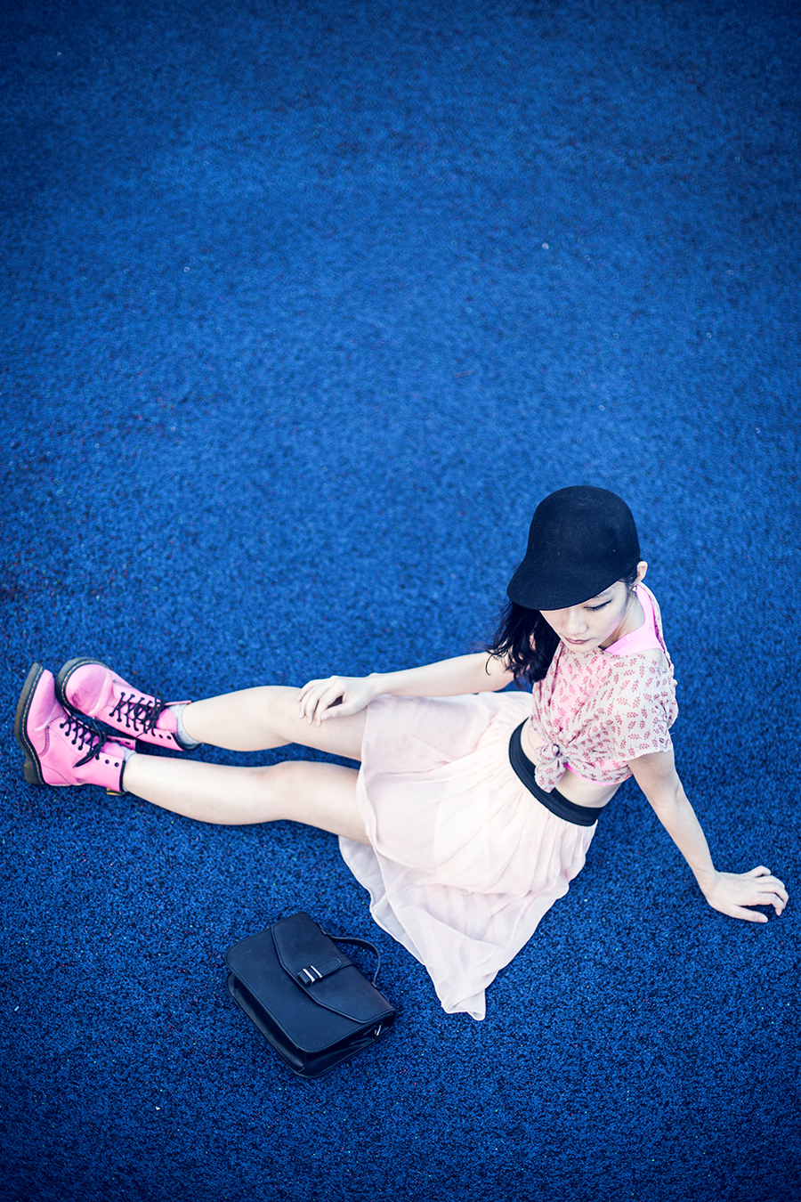 Close-up of neon pink outfit: neon pink We Love Colors sports bra, black felt jockey hat from Taobao, vintage earrings, Forever 21 tulip back chiffon top, pink high-low skirt from Korea, Dr Martens hot pink 8eye boots, Zalora black satchel.