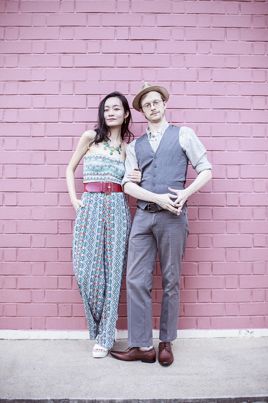 Couple outfit photo of Ren and Ottie featuring American Rag jumpsuit, Accessorize red belt, Topman grey vest, Topman grey slacks, Black Hammer brown loafers.