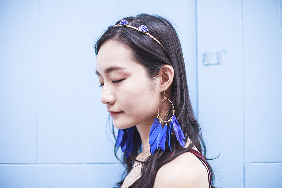 Bohemian Rhapsody Outfit: paper floral headband from Bangkok, H&M blue feather hoop earrings.