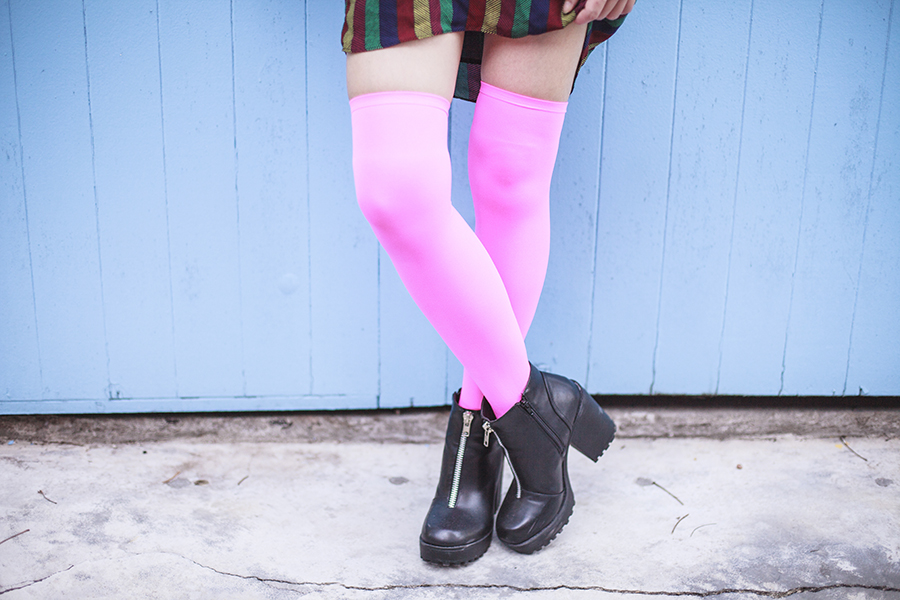 Bohemian Rhapsody Outfit: Urban Outfitters striped off-shoulder dress, We Love Colors neon pink thigh high stockings, Rubi black platform zipper boots.