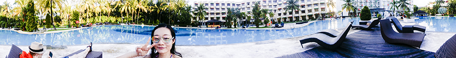 Panoramic view of the pool while lounging at Harris Waterfront Resort, Batam, Indonesia.