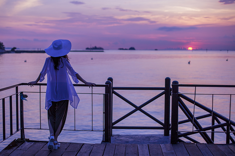 Gazing at the sunset over Singapore from the jetty at Turi Beach Resort, Batam, Indonesia.