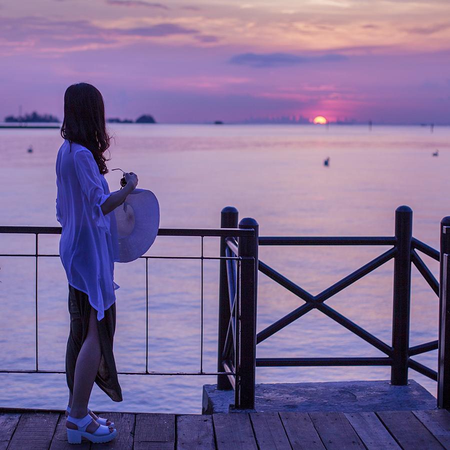 Gazing at the sunset over Singapore from the jetty at Turi Beach Resort, Batam, Indonesia.