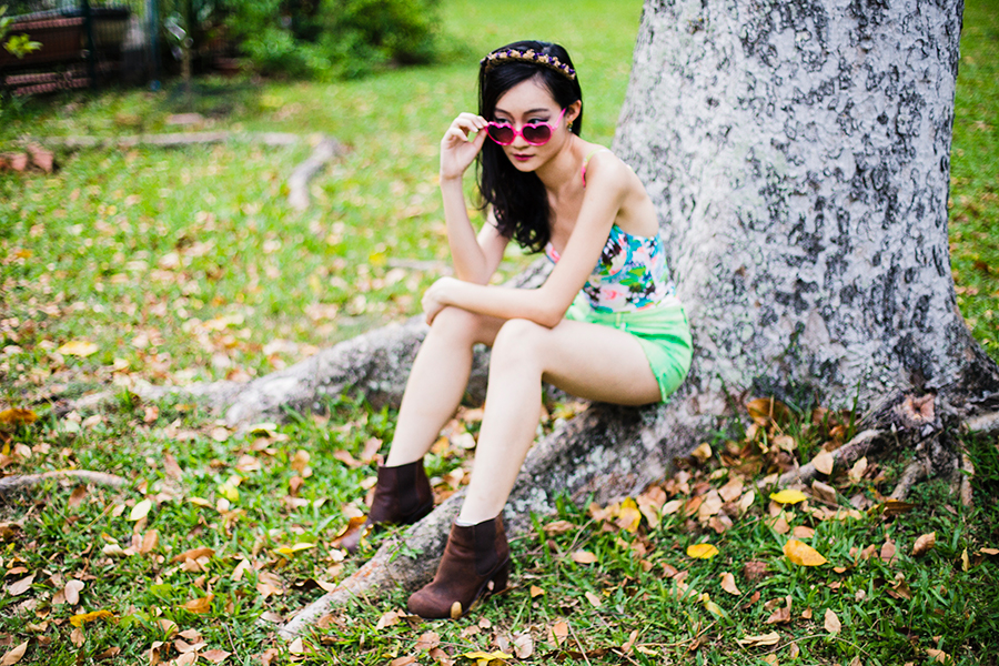 Florals in Green Outfit: Vedette Shapewear Bessie Swimwear Shapewear, Forever 21 lime green denim cutoff shorts, Osewaya mermaid ear studs via JRunway, pink heart-shaped sunglasses, Garlands and Gardens floral headband, Jeffrey Campbell leather heeled boots via Chictopia Shop.