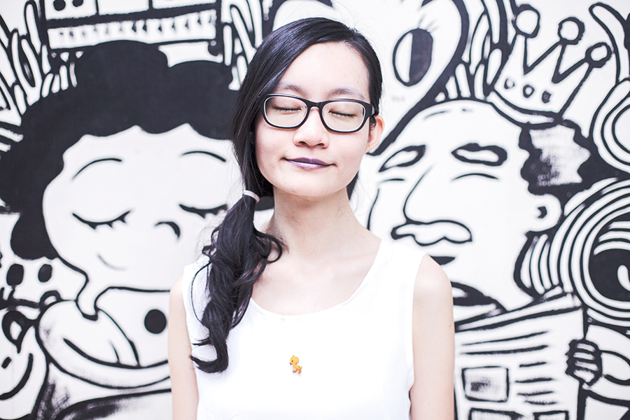 Casual Outfit: DressLink open back white chiffon top, Gap black frame glasses, L.A. Colors purple lipstick, Vintage duckie wooden pin. Against a Band of Doodlers wall mural in Macpherson, Singapore.