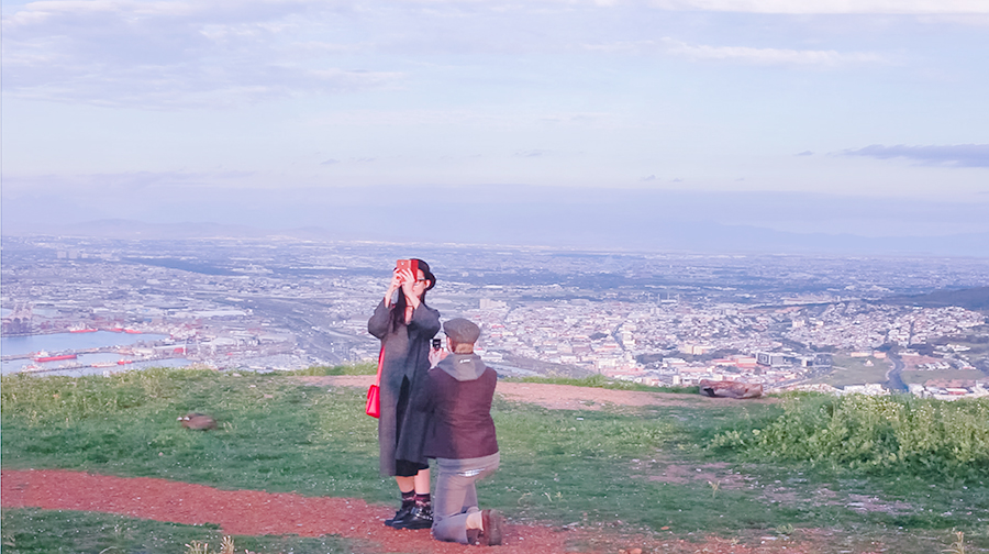 Screenshot of a video showing the surprise engagement proposal atop Signal Hill, Cape Town, South Africa.
