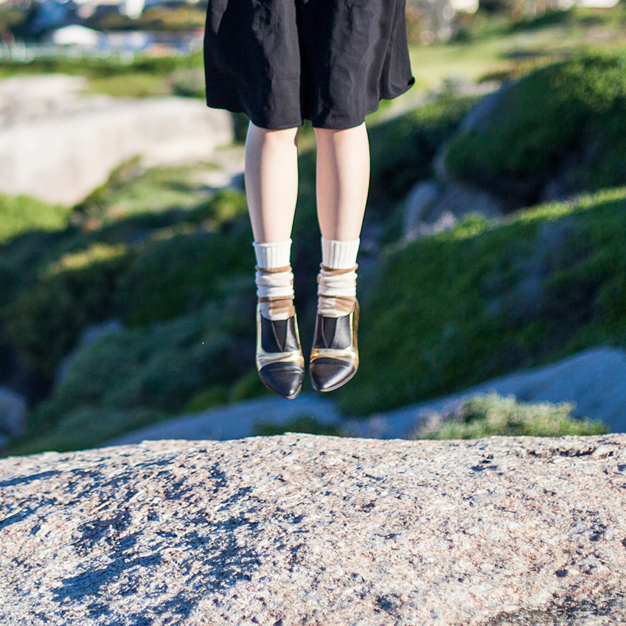Outfit at Boulders Beach, Table Mountain National Park, Cape Town, South Africa: Lowry's Farm black midi skirt with pockets, Anonymous Ism patchwork crew socks via Shopbop, Something Borrowed black & gold pointed flats via Zalora.