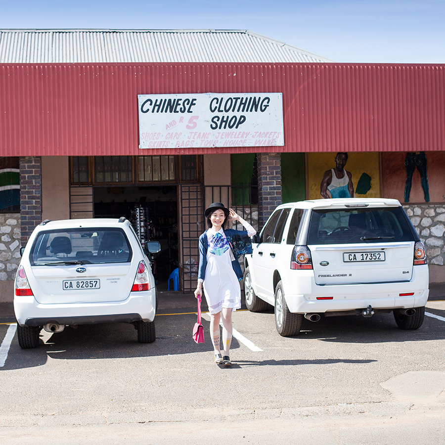 Standing in front of the Chinese Clothing Shop in Darling, South Africa.