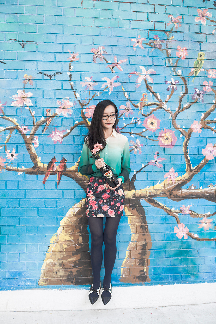 Floral outfit: Romwe green ombre chiffon shirt, Forever 21 floral skirt, Something Borrowed cutout oxford flats, Gap glasses. A bottle of Baileys.