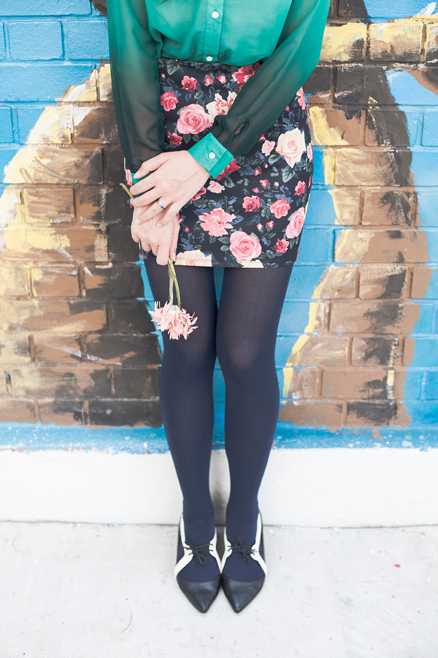 Holding onto pink flowers in a floral ootd.