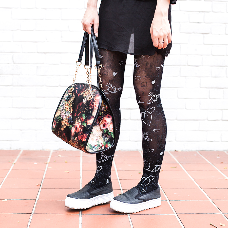 Floral bag and patterned Vivienne Westwood tights.